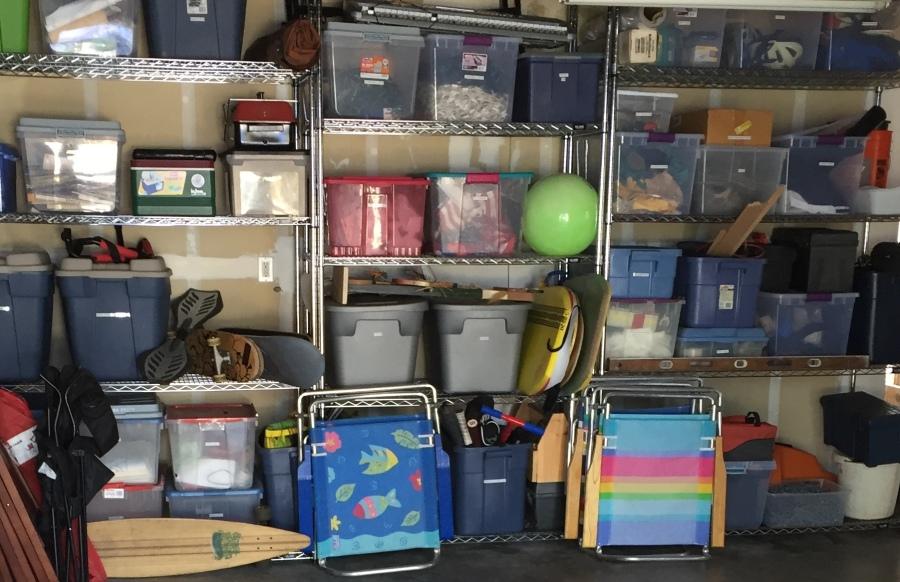 Garage with organized plastic bins